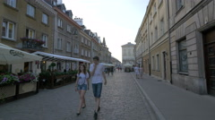 Gospoda pod Kogutem and other outdoor restaurants on Freta street, Warsaw Stock Footage