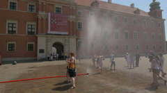 Refreshing water vapour machine on a sunny day in Castle Square, Warsaw Stock Footage
