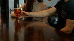 Smiling couple having a drink together Stock Footage