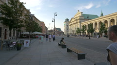 Walking and sitting on benches on Krakowskie Przedmiescie street in Warsaw Stock Footage