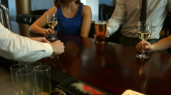 Happy friends having a drink together Stock Footage