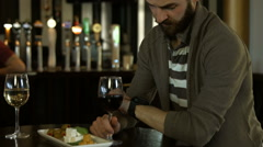 Attractive couple talking at the bar Stock Footage