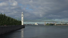 Pan, Montreal clock tower and Jacques Cartier Bridge, Canada Stock Footage