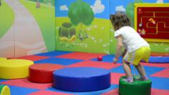 Cute excited kid jumping Stock Footage