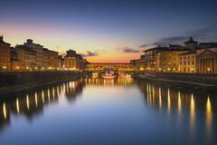 Stock Photo of Ponte Vecchio on sunset, old bridge, medieval landmark on Arno river. Florenc