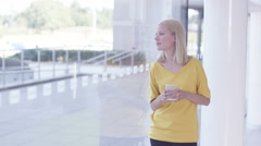 4K Businesswoman alone with her thoughts as she looks out of office window - stock footage