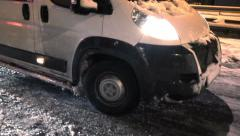 Close-up shot of a car tire struggling to catch grip on an icy cold snowy street Stock Footage