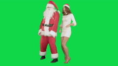 Christmas girl with santa claus dance on a Green Screen Chrome Key - stock footage