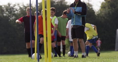 Stock Video Footage of Soccer coach is pleased with a young player and gives him a high five.