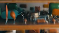 The camera moves up along several printed circuit boards with the items. Macro  Stock Footage