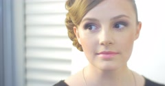 Stock Video Footage of Happy Blonde Woman Model With New Hairstyle And Makeup Posing in front of