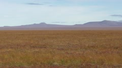 Driving Shot of Arctic Tundra Plains Scenery in Autumn in Alaska Stock Footage