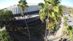 4K rising aerial shot of Los Angeles Sports Arena and palm trees Arkistovideo