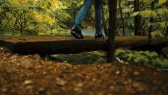 Walking on a wooden bridge, autumn scenery Stock Footage