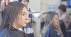 Stock Video Footage of Stylist Hairdresser is Drying a Hairs With Dryer Making The Hairstyle For a