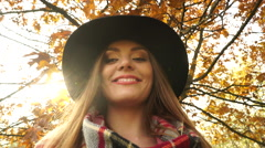 Woman relaxing in autumn fall park forest 4K. - stock footage