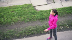 Male jogger with smartwatch and sportive woman talking in the city Stock Footage