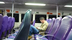 Alone passenger sit in modern ferry ship, look to smart phone, texting Stock Footage
