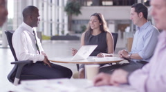 4K Mixed ethnicity business group chatting in large modern office building Stock Footage