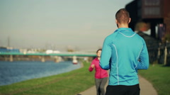Stock Video Footage of Personal trainer with tablet congratulate young female jogger after run