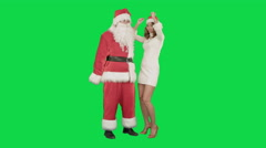 Christmas happy smile girl dancing with Santa Claus on a Green Screen Chrome Key - stock footage