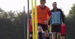 Soccer coach psyching up a young player during training session.Shot on RED Epic - stock footage