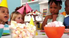 Happy kids at a birthday party - stock footage