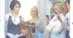 Stylist Hairdresser Shows How to Make a Hairstyle Woman with Long Hairs Women Stock Footage