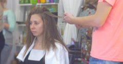 Stylist Hairdresser in Pink T-Shirt Making Hairstyle Smal Curls Hairs Volume by Stock Footage