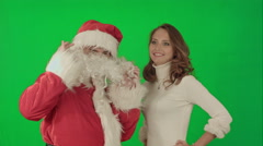 Beautiful christmas woman dancing with Santa Claus on a Green Screen Chrome Key - stock footage