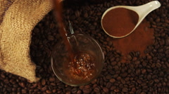 Coffee pouring into a glass cup Stock Footage
