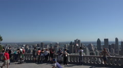 Tourists visit Mont Royal to see the Montreal skyline, Canada Stock Footage