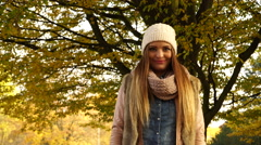 Woman with pills tablets in autumn fall park 4K. Stock Footage