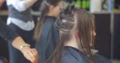 Stylist Hairdresser is Making a Fire Cut Model's Wet Hairs Woman with Long Stock Footage