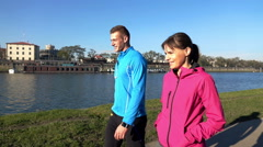 Young, sportive couple talking and walking in the city Stock Footage