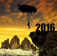 Silhouette skydiver parachutist landing in to the New Year 2016 Stock Photos