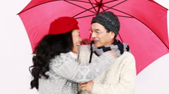 Stock Video Footage of Mature Asian couple under an umbrella