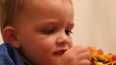 Stock Video Footage of A little boy eats a taco for dinner