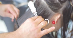 Stylist Hairdresser is Making The Fire Cut For a Woman with Long Hairs in Salon Stock Footage