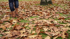 Woman walking on autumn fall grass steadicam 4K. - stock footage