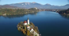 Aerial view of St Martin church on island and Bled lake landscape with mountain Stock Footage