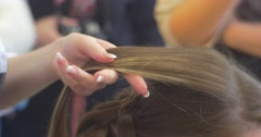 Stylist Hairdresser is Combing The Colored Blond Hair Strand and Fixing it as a Stock Footage