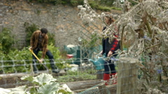 Young couple gardening Stock Footage