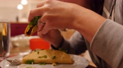 A woman eats a taco for dinner - stock footage