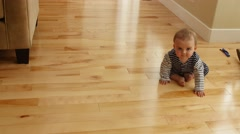 Little baby boy scooting on his bum in his house Stock Footage