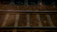Horizontal movement from train window with railway closeup. Loopable - stock footage
