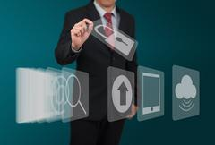 man select computer icon on touch screen - stock photo