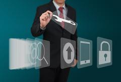 Stock Photo of man select computer icon on touch screen