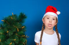 The girl in a red cap puts out the tongue Stock Photos