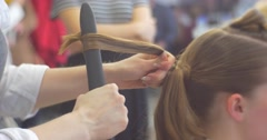 Stylist Hairdresser is Making The Hairstyle Curls by Curling Irons For a Woman - stock footage